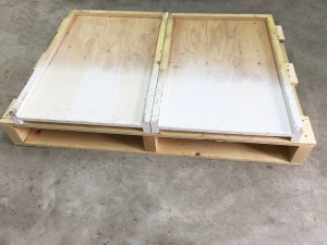 The top insides of bottom boards don't require paint.